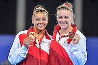 Rebecca Downie; Ruby Harrold  of GBR pose with gold and silver medal in uneven bars during Commonwealth Games artistic gymnastics, Thursday, July 31, 2014 in Glasgow, United Kingdom. (Mo Khursheed/TFV Media via AP Images)