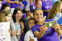 Orlando, FL - Saturday March 24, 2018: Orlando Pride forward Marta Vieira da Silva (10) takes a selfie with fans after a regular season National Women's Soccer League (NWSL) match between the Orlando Pride and the Utah Royals FC at Orlando City Stadium. The game ended in a 1-1 draw.