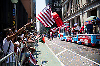 NEW YORK, NEW YORK - JULY 7: Hundreds of people cheer as police, firefighters, hospitals and other first responders participate in a parade of ticker tapes to honor workers who helped in New York during the Covid pandemic -19 on July 7, 2021 in New York City. Healthcare workers, first responders and essential workers are honored at the Canyon of Heroes in Manhattan for their service during the COVID-19 pandemic. (Photo by Pablo Monsalve / VIEWpress via Getty Images)