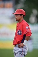 Williamsport Crosscutters Jesus Azuaje (4) coaches first base during a game against the Batavia Muckdogs on August 19, 2017 at Dwyer Stadium in Batavia, New York.  Batavia defeated Williamsport 11-1 in five innings due to rain.  (Mike Janes/Four Seam Images)