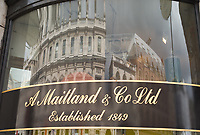 Building reflection in the store window of A. Maitland & Co, Picadilly Arcade (replaced by Santa Maria Novella)