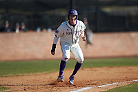 Brady Pearre (2) of the High Point Panthers takes his lead off of third base against the Bryant Bulldogs at Williard Stadium on February 21, 2021 in  Winston-Salem, North Carolina. The Panthers defeated the Bulldogs 3-2. (Brian Westerholt/Four Seam Images)