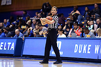 DURHAM, NC - NOVEMBER 17: Game official Dee Kantner holds the ball during a game between Northwestern University and Duke University at Cameron Indoor Stadium on November 17, 2019 in Durham, North Carolina.