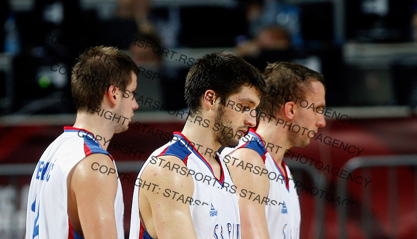 Stefan MARKOVIC (Serbia), Novica VELICKOVIC (Serbia) and Dusko SAVANOVIC (Serbia) after defeat during the 3rd Place World championship basketball match against Lithuania in Istanbul, Serbia-Lithuania, Turkey on Sunday, Sep. 12, 2010. (Novak Djurovic/Starsportphoto.com) .