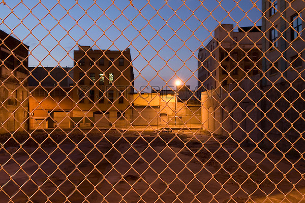 Mysterious Urban Scene - Empty Lot in the Vinegar Hill Neighborhood of Brooklyn, Viewed thru Chain Link Fence at Dusk,  New York City, New York State, USA