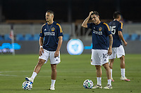 SAN JOSE, CA - OCTOBER 03: Javier Hernandez #14 and Cristian Pavon #10 of the LA Galaxy warming up during a game between Los Angeles Galaxy and San Jose Earthquakes at Earthquakes Stadium on October 03, 2020 in San Jose, California.