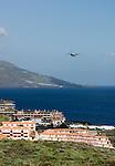Spain, Canary Islands, La Palma, Los Cancajos: resort at the east coast, airplane, background Santa Cruz de La Palma
