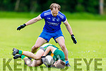 Eamonn Hickson of Annascaul puts the pressure on John Walsh of Knocknagoshel who goes to ground in possession in the Kerry Junior Club Championship round 1 game on Sunday.