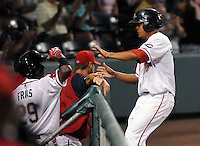 Infielder Reynaldo Rodriguez (47) of the Greenville Drive is congratulated after scoring a run in Game 1 of the South Atlantic League Southern Division Championship against the Savannah Sand Gnats on Sept. 8, 2010, at Fluor Field at the West End in Greenville, S.C. Photo by: Tom Priddy/Four Seam Images