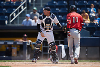 Scranton/Wilkes-Barre RailRiders catcher Donny Sands (33) applies a tag to Humberto Arteaga (11) of the Rochester Red Wings at PNC Field on July 25, 2021 in Moosic, Pennsylvania. (Brian Westerholt/Four Seam Images)