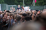 © Joel Goodman - 07973 332324 . 05/06/2015 . Manchester , UK . Man crowdsurfing . Evening concerts featuring headliners , The Courteeners , playing a homecoming gig , at Heaton Park in Manchester in front of 25,000 people , the evening before the Parklife music festival . Photo credit : Joel Goodman