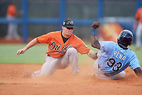Baltimore Orioles Cadyn Grenier (54) tags Tony Pena (93) as he slides into second base during a Florida Instructional League game against the Tampa Bay Rays on October 1, 2018 at the Charlotte Sports Park in Port Charlotte, Florida.  (Mike Janes/Four Seam Images)
