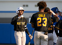 Montverde Academy Eagles Cadmiel Pompa (31) fist bumps teammates after hitting a home run during a game against the IMG Academy Ascenders on April 8, 2021 at IMG Academy in Bradenton, Florida.  (Mike Janes/Four Seam Images)