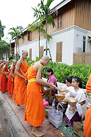 Monks and novices receive symbolic alms on July 8, 2017, in Luang Prabang, Laos.