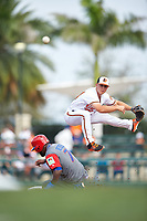 Baltimore Orioles second baseman Sean Coyle (84) turns a double play as Jose Reyes (7) slides in during a Spring Training exhibition game against the Dominican Republic on March 7, 2017 at Ed Smith Stadium in Sarasota, Florida.  Baltimore defeated the Dominican Republic 5-4.  (Mike Janes/Four Seam Images)