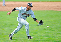 3 July 2011: Tri-City ValleyCats pitcher Ebert Rosario makes a play against the Vermont Lake Monsters at Centennial Field in Burlington, Vermont. The Lake Monsters rallied from a 6-3 deficit, scoring 4 runs in the bottom of the 9th, to defeat the ValletCats 7-6 in NY Penn League action. Mandatory Credit: Ed Wolfstein Photo