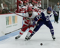 Boston, Massachusetts - February 9, 2019: NCAA Division I. Boston University (white) defeated College of the Holy Cross (purple), 7-1, at Walter Brown Arena.