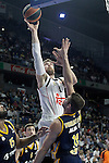 Real Madrid's Andres Nocioni (l) and Alba Berlin's Jonas Wohlfarth during Euroleague match.March 12,2015. (ALTERPHOTOS/Acero)