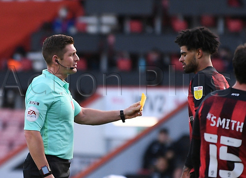 31st October 2020; Vitality Stadium, Bournemouth, Dorset, England; English Football League Championship Football, Bournemouth Athletic versus Derby County; Referee Robert Jones shows a yellow card to Philip Billing of Bournemouth