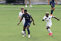CARY, NC - AUGUST 01: Hadji Barry #92 is challenged by Anderson Asiedu #6 and Jonathan Dean #24 during a game between Birmingham Legion FC and North Carolina FC at Sahlen's Stadium at WakeMed Soccer Park on August 01, 2020 in Cary, North Carolina.