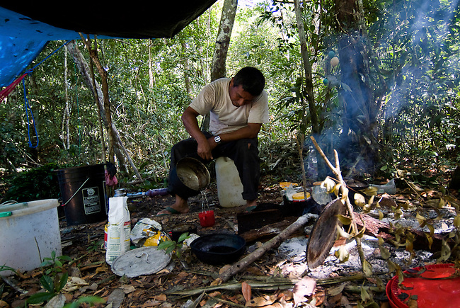 A Xate gatherer at his camp in the Mayan Biosphere where he gathers Xate, a fern sold with flowers throughout the US and Europe. Helping Guatemalan's sustainable benefit from the Mayan Biosphere is key the reserves survival.