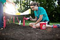 """A member paints a playground slide during """"Circle the City with Service,"""" the Kiwanis Circle K International's 2015 Large Scale Service Project, on Wednesday, June 24, 2015, at the Friendship Westside Center for Excellence in Indianapolis. (Photo by James Brosher)"""