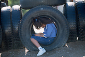 MR / Schenectady, NY. Rosendale Elementary School. Depressed student (girl, 6, African American) inside tire structure on playground at freetime. MR: Mos4. ID: AJ-LC. © Ellen B. Senisi