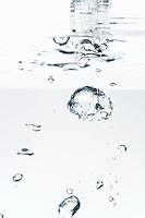 Bubbles underwater, white background, studio