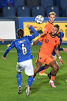 Marco Verratti of Italy and Memphis Depay of Netherlands compete for the ball during the Uefa Nation A League Group 1 football match between Italy and Netherlands at Atleti azzurri d Italia Stadium in Bergamo (Italy), October, 14, 2020. Photo Andrea Staccioli / Insidefoto
