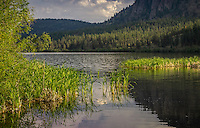 Landscape Scenic Art Photograph of the last rays of sunshine setting on Vaseux Lake in the mountains of British Columbia, Canada.