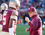 Florida State head coach Jimbo Fisher gives a fist bump to his Heisman trophy winning quarterback Jameis Winston in pre game warm ups.  The Florida State Seminoles defeated the Florida Gators 24-19 in an NCAA football game in Tallahassee, November 29, 2014.