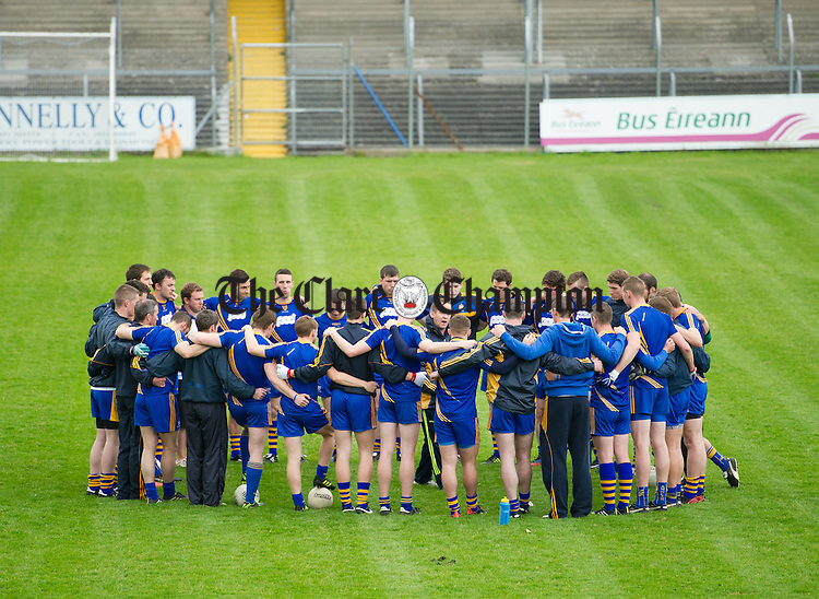 Clare manager Colm Collins talks to his players in Cusack park during preparations for their forthcoming SFC Munster quarter final against Waterford. Photograph by John Kelly.