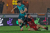 (L-R) Rory Scannell of Muster is brought down by Ioan Nicholas of the Scarlets during the Guinness Pro14 Round 17 match between the Scarlets and Munster Rugby at the Parc Y Scarlets Stadium, Llanelli, Wales, UK. Saturday 02 March 2019