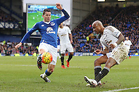 Bryan Oviedo blocks the shot on goal by Andre Ayew during the Barclays Premier League match between Everton and Swansea City played at Goodison Park, Liverpool