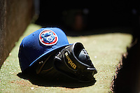 South Bend Cubs hat and a Wilson glove on the dugout step during a game against the Lake County Captains on July 27, 2016 at Classic Park in Eastlake, Ohio.  Lake County defeated South Bend 5-4.  (Mike Janes/Four Seam Images)