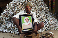 Balkaur Singh (52) holds a portrait of his late mother Mukhtyar Kaur, who died in 2013 of breast and liver cancer, aged 75. It is believed that excessive pesticide use in the region over the past 30-40 years has led to the accumulation of dangerous levels of toxins such as uranium, lead and mercury which are contributing to increased health problems including cancers, birth defects and mental disabilities in children. It's a hidden epidemic which is gripping the Punjab region in northeast India which for decades has been the country's 'bread basket'. As local farmers and their families continue to get ill they are paying the price for the country's 'Green Revolution'.