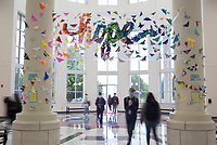 "Students head to their classes as they pass a new art installation, Friday, September 11, 2020 at Springdale High School in Springdale. About 600 Springdale High School art students and all of the art teachers created a large origami butterfly installation to hang in the school's rotunda. The theme is ""hope"", and each student wrote a personal hope or dream on origami paper then folded it into a butterfly. Check out nwaonline.com/200912Daily/ for today's photo gallery. <br /> (NWA Democrat-Gazette/Charlie Kaijo)"