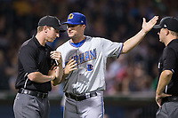 Durham Bulls manager Jared Sandberg (22) argues a call with third base umpire Alex Tosi as first base umpire Brian Peterson looks on during the game against the Charlotte Knights at BB&T BallPark on May 15, 2017 in Charlotte, North Carolina. The Knights defeated the Bulls 6-4.  (Brian Westerholt/Four Seam Images)