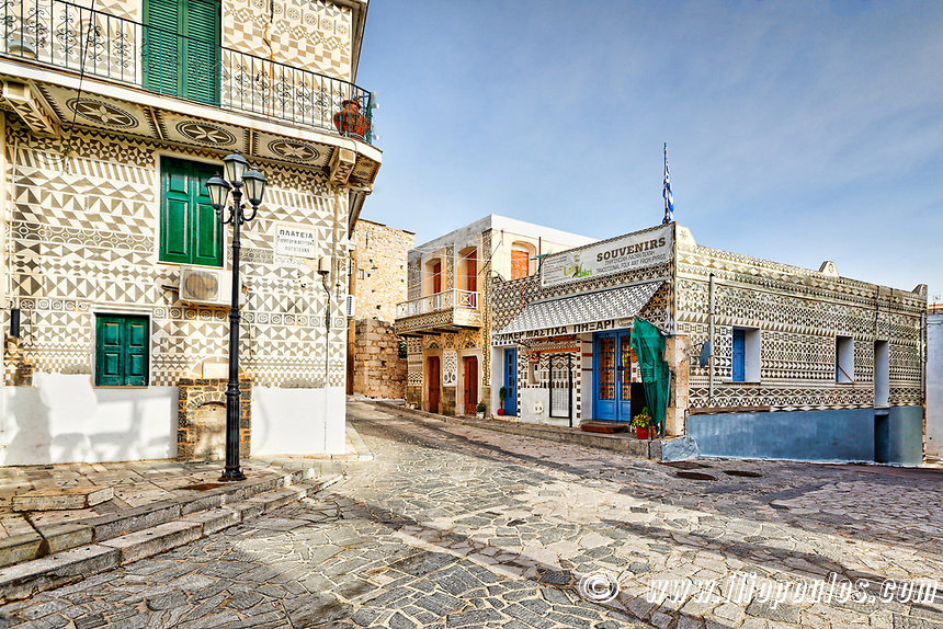 Traditional houses decorated with the famous geometric scratch patterns in the medieval  mastic village of Pyrgi on the island of Chios, Greece