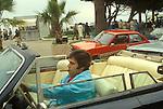 Cannes Film Festival 1980. France. Film industry executive in an open top Rolls Royce and smoking a cigar driving along the  Promenade de la Croisette,  or known as the Boulevard de la Croisette.