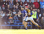 Michael Hawes of Cratloe in action against Pierse Lillis of  Ballyea during the county senior hurling final at Cusack Park. Photograph by John Kelly.