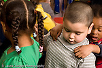 Education Preschool 4-5 year olds three children in line horizontal