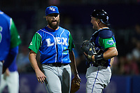 Lexington Legends relief pitcher Derek Self (11)celebrates with catcher Jordan Pacheco (40) after getting the final out in the game against the High Point Rockers at Truist Point on June 16, 2021, in High Point, North Carolina. The Legends defeated the Rockers 2-1. (Brian Westerholt/Four Seam Images)