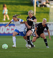 Boston Breakers  midfielder Kristine Lilly (13) pushes through Washington Freedom midfielders Allie Long (9) and Lori Lindsey (6) Boston Breakers defeated Washington Freedom 3-1 at The Maryland SoccerPlex, Saturday April 18, 2009.