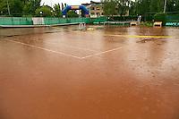 August 22, 2014, Netherlands, Amstelveen, De Kegel, National Veterans Championships, rain<br /> Photo: Tennisimages/Henk Koster