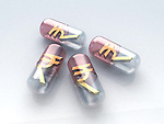 Capsules with contents of Indian rupee symbol