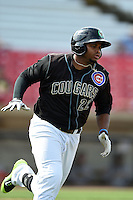 Kane County Cougars outfielder Yasiel Balaguert (22) runs to first during a game against the Quad Cities River Bandits on August 20, 2014 at Third Bank Ballpark in Geneva, Illinois.  Kane County defeated Burlington 7-3.  (Mike Janes/Four Seam Images)