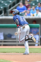 Mississippi Braves center fielder Michael Reed (28) runs to first base during a game against the Tennessee Smokies at Smokies Stadium on May 20, 2018 in Kodak, Tennessee. The Braves defeated the Smokies 7-4. (Tony Farlow/Four Seam Images)