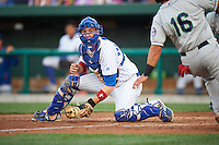 South Bend Cubs catcher Cael Brockmeyer (9) tags out T.J. White (16) at home during a game against the Cedar Rapids Kernels on June 5, 2015 at Four Winds Field in South Bend, Indiana.  South Bend defeated Cedar Rapids 9-4.  (Mike Janes/Four Seam Images)
