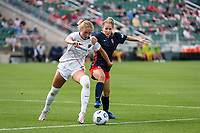 CARY, NC - APRIL 10: Schuyler DeBree #15 of the NC Courage battles for the ball with Ashley Sanchez #10 of the Washington Spirit during a game between Washington Spirit and North Carolina Courage at Sahlen's Stadium at WakeMed Soccer Park on April 10, 2021 in Cary, North Carolina.